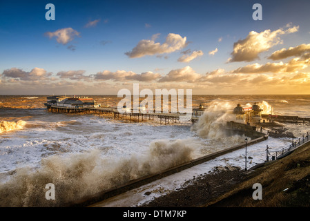 The North Sea tidal surge continues to pound the Victorian Pier and promenade at Cromer, Norfolk Coast, UK.  December - Stock Photo