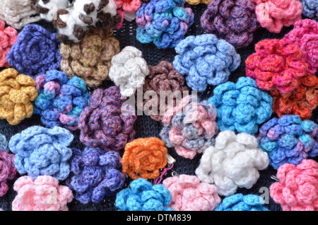 Crocheted flowers on display in the market. - Stock Photo