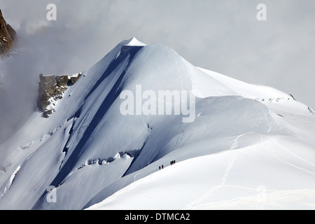 Climbers descending from the summit of Mont Blanc in the French Alps above Chamonix. - Stock Photo