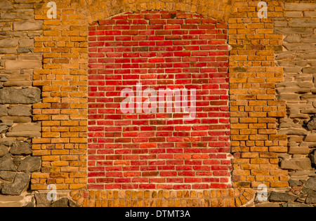 Brightly colored bricks stand out as they cover an old underground access point in a North American city. - Stock Photo
