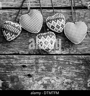 Hearts on wooden background - Stock Photo
