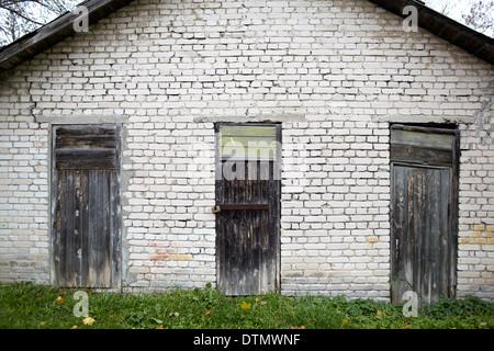 Three doors in the old garage. - Stock Photo