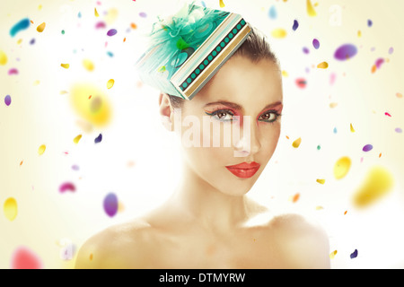 Young lady wearing gift-hat - Stock Photo