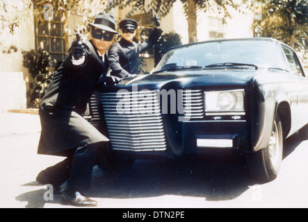 THE GREEN HORNET  1966-67 ABC TV series with Van Williams at left and Bruce Lee and their Black Beauty car - Stock Photo