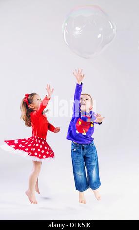 Two cute kids having great fun - Stock Photo
