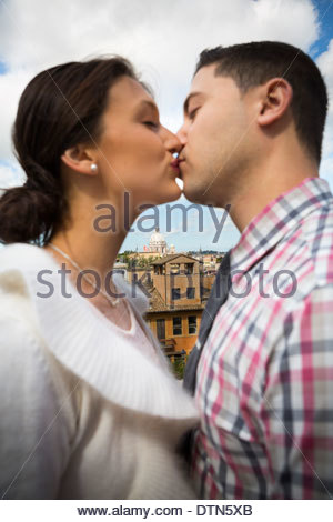 Couple kissing in Rome, Italy. - Stock Photo
