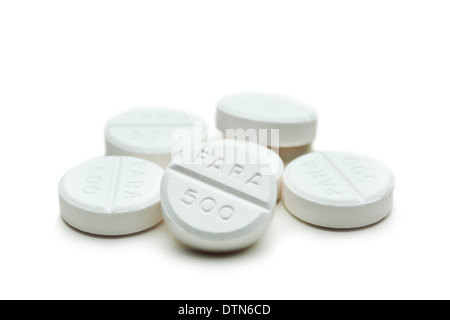 Loose paracetamol tablets on a white background - Stock Photo