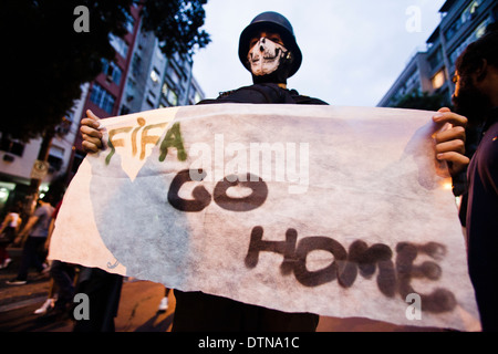 FIFA go home - Demonstration in Rio de Janeiro against realization of 2014 Soccer Wold Cup in Brazil, June, 30th, - Stock Photo
