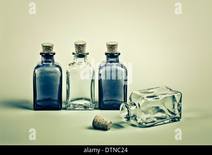 Four empty mini glass bottles - Stock Photo
