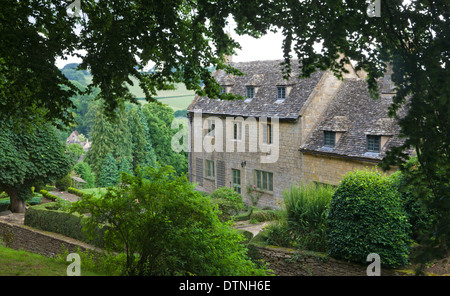 Stone cottage in the picturesque Cotswolds village of Snowshill, Worcestershire, England. Summer (July) 2010. - Stock Photo