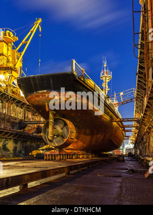 Ship repair in Dry Dock at night. - Stock Photo