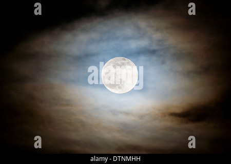 Full moon rising over Rocky Mountains, Salida, Colorado, USA - Stock Photo