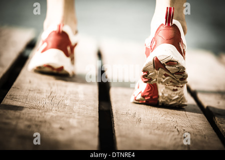 Feet of jogging person - Stock Photo