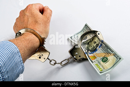 Man made prisoner to cold hard cash. - Stock Photo