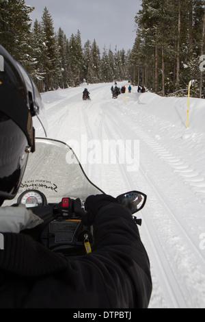 Snowmobile Tour through the Yellowstone National - Stock Photo