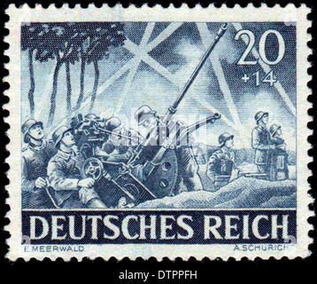 A German postage stamp from WW2 depicting German anti aircraft troops - Stock Photo
