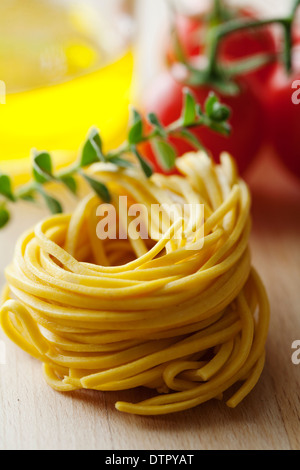 fresh tagliatelle with some ingredients - Stock Photo