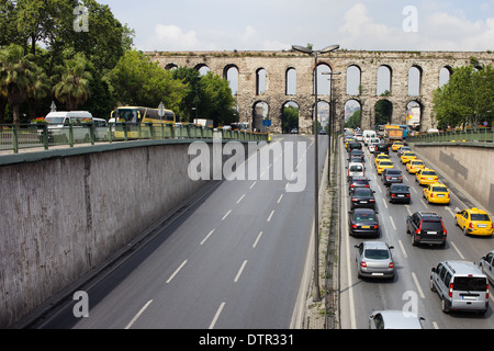 Cars on Ataturk Boulevard and Valens Aqueduct in Istanbul, Turkey. - Stock Photo