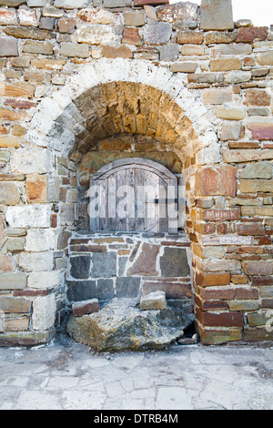 Ancient wooden window of medieval brick wall - Stock Photo