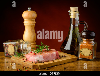 still life with raw pork meat steak and spices - Stock Photo
