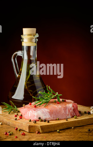 still life with raw pork meat steak, spices and olive oil - Stock Photo