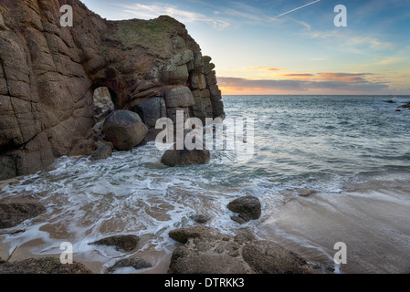 Cliffs and sea caves at Porthqwarra Cove on the Lands End Peninsula near Penzance - Stock Photo
