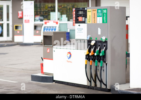 Total Gas Station Petrol Pumps on forecourt - Stock Photo