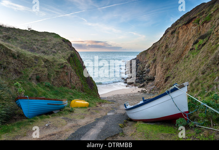 Fishing boats at Porthgwarra Cove in Cornwall - Stock Photo