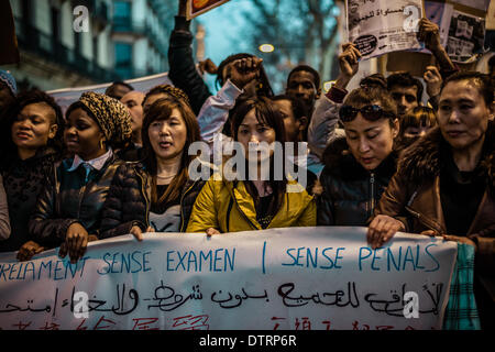 Barcelona, Spain. February 23rd, 2014: Immigrants behind their banner shout slogans marching through the city of - Stock Photo