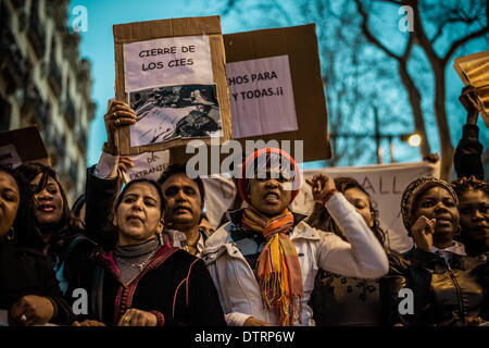 Barcelona, Spain. February 23rd, 2014: Immigrants holding placards march for immigration rights and papers through - Stock Photo