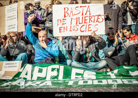 Barcelona, Spain. February 23rd, 2014: Immigrants holding placards concentrate for immigration rights and papers - Stock Photo