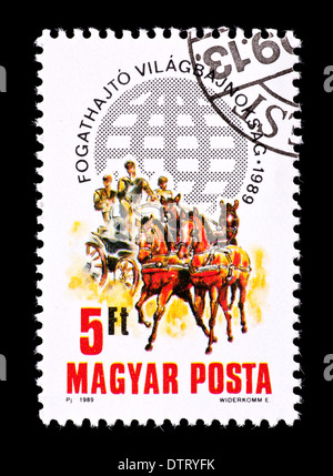 Postage stamp from Hungary depicting the two-in-hand Carriage-driving Championships - Stock Photo