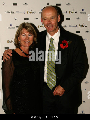 Former Rugby coach Sir Clive Woodward with wife at the Cnacer Research Charity event in London - Stock Photo