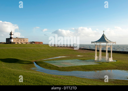 the bandstand at Southsea seafront nearly flooded with rain water after heavy winter storms - Stock Photo