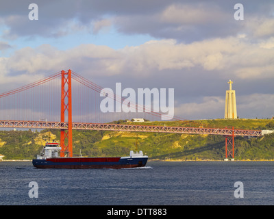25 de Abril Bridge over the Tagus River in Lisbon, Portugal - Stock Photo