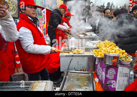 Temple Fair of Chinese Spring Festival in Beijing - Stock Photo