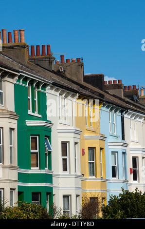 A row of colourful terrace houses in Brighton's Queen's Park Road - Stock Photo