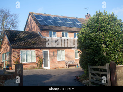 Solar panels on roof of residential property in Woodbridge, Suffolk, England - Stock Photo