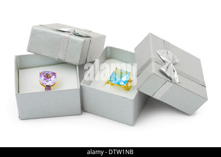 Gold rings in boxes - Stock Photo