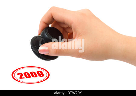 Hand with stamp 2009 - Stock Photo