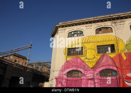 Rome, Italy. 24th Februrary 2014. Street Art by the artist Blu on an old military barracks building in the Ostiense - Stock Photo