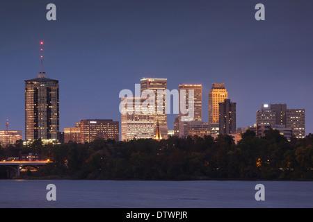 USA, Oklahoma, Tulsa, skyline from the Arkansas River at dusk - Stock Photo