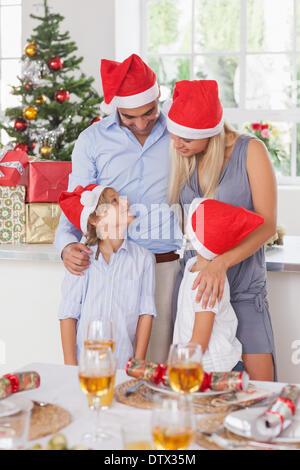 Happy family at christmas - Stock Photo