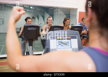 Happy people in spinning class - Stock Photo
