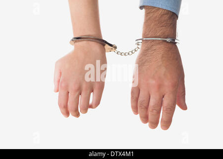 Hands of business people in handcuffs - Stock Photo