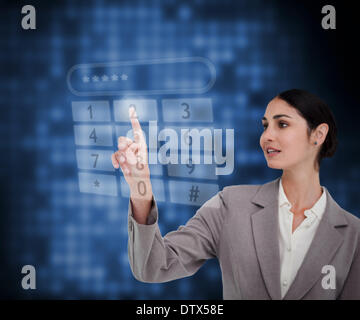 Businesswoman dialing a number - Stock Photo