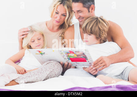 Family reading a story together - Stock Photo
