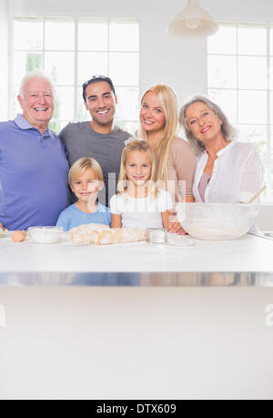 Smiling family posing in the kitchen - Stock Photo
