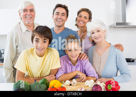 All the family smiling in kitchen - Stock Photo