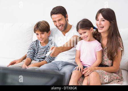Happy family watching television - Stock Photo